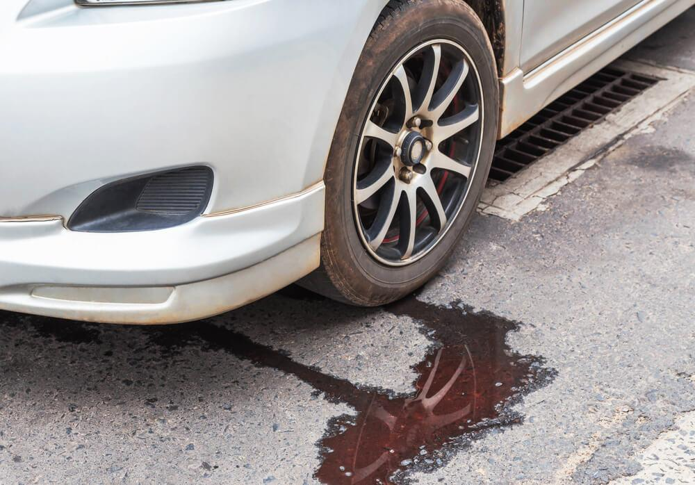 Is It Safe Driving With Red Fluid Leaking From Car Car